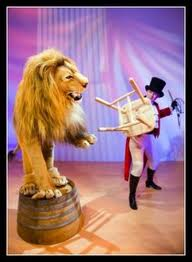 This image has an empty alt attribute; its file name is lion-tamer.jpg