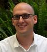 RYAN GRABENKORT, Managing Director, Media