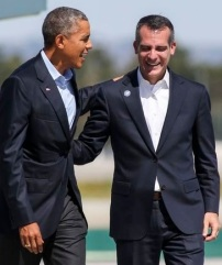 President Barack Obama, center, is greeted by Los Angeles Mayor Eric Garcetti, left, as he arrives on Air Force One at Los Angeles International Airport in Los Angeles on Saturday, Oct. 10, 2015. (AP Photo/Ringo H.W. Chiu)