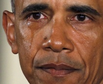 U.S. President Barack Obama is seen in tears while delivering a statement on steps the administration is taking to reduce gun violence in the East Room of the White House in Washington January 5, 2016. Vice President Joe Biden is at right. REUTERS/Carlos Barria - RTX215LJ