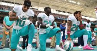 Oct 16, 2016; Miami Gardens, FL, USA; From left Miami Dolphins wide receiver Kenny Stills (10), free safety Michael Thomas (31) and Miami Dolphins defensive back Arian Foster (29) kneel during the National Anthem before the game against the Pittsburgh Steelers at Hard Rock Stadium. Mandatory Credit: Jasen Vinlove-USA TODAY Sports
