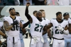 Philadelphia Eagles' Chris Long, from left, Malcolm Jenkins and Rodney McLeod stand on the sidelines during the playing of the National Anthem before a preseason NFL football game against the Miami Dolphins, Thursday, Aug. 24, 2017, in Philadelphia. (AP Photo/Matt Rourke)