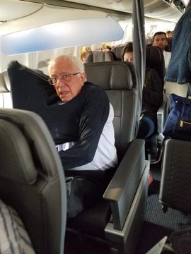 BERNIE IN FIRST CLASS