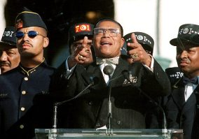 Nation of Islam leader Louis Farrakhan addresses the Million Man March, Monday Oct. 16, 1995 on Capitol Hill. Farrakhan proclaimed divine guidance in bringing to Washington the largest assemblage of black Americans since the 1963 March on Washington. Farrakhan's son Mustafa is at left. (AP Photo/Doug Mills)