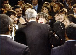 PKT5649-416203 WILLIAM CLINTON PRESIDENT Monica Lewinsky embraces U.S President Clinton at a democratic fundraiser. This is the moment that Bill Clinton could live to regret. Because if it ever comes to impeachment, it will be his breathtaking recklessness that costs him the US Presidency. Millions of American voters will be examining the astonishing photograph when it is published across their nation this week, and asking themselves if the greeting betrays more than just a kiss. Amid a sea of laughing faces, with two secret secret service bodyguards just behind him and a photographer shooting over their shoulders, the President embraces White House assistant Monica Lewinsky with abandon.