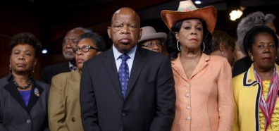 Civil right leader Rep. John Lewis, D-Ga., center, and other members of the Congressional Black Caucus gather to condemn the slayings of police officers in Dallas last night, and to denounce the fatal police shootings of black men in Louisiana and Minnesota earlier in the week, during a news conference, Friday, July 8, 2016, on Capitol Hill in Washington. From left are: Rep. Barbara Lee, D-Calif., Rep. Danny K. Davis, D-Ill., Rep. Marcia L. Fudge, D-Ohio, Rep. John Lewis, D-Ga., Rep. Alma Adams, D-N.C., Rep. Frederica Wilson, D-Fla., and Rep. Sheila Jackson Lee, D-Texas. (AP Photo/J. Scott Applewhite)